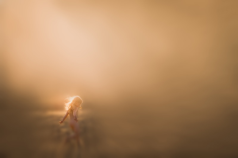 Personal Work, blurry image of little girl running through a field