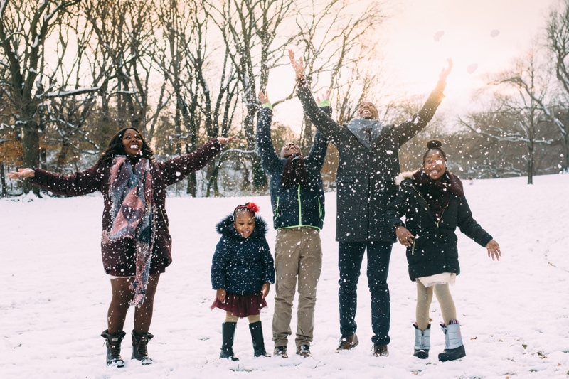 family photography, family throwing snow into the air