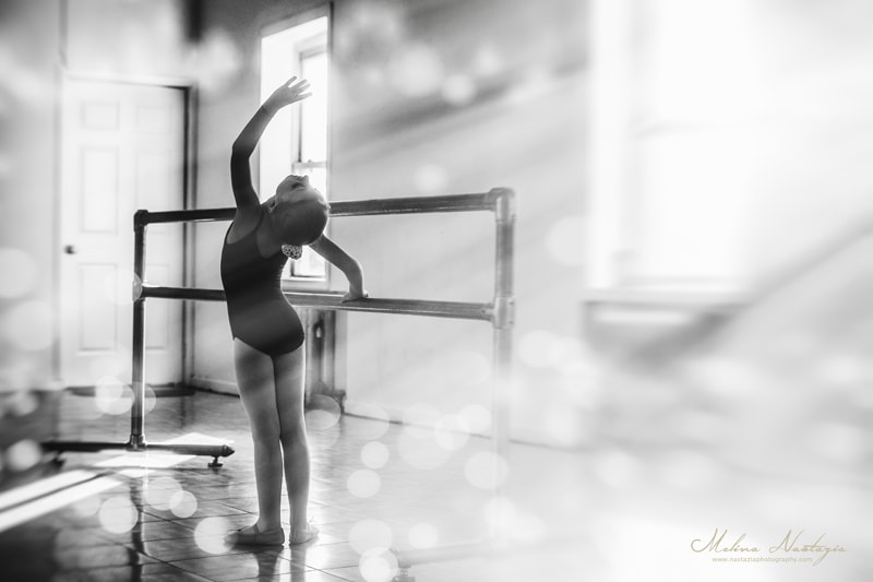 artist photography, black and white of dancer with sunlight coming in through window