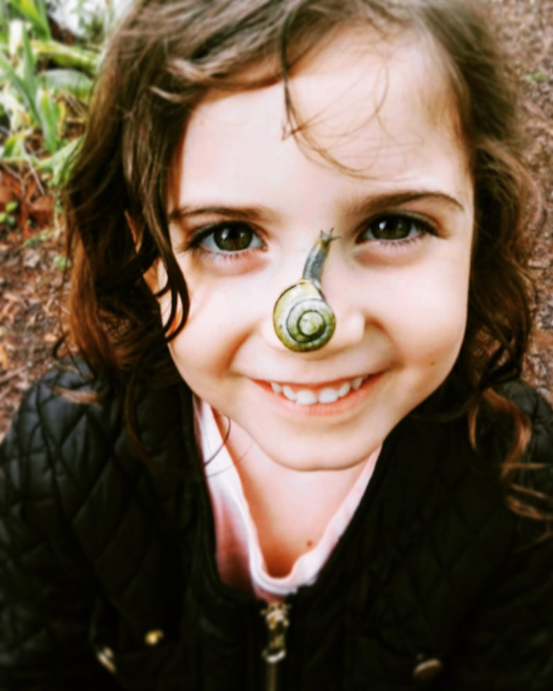 Children and Senior Photography, young child with a snail on their nose