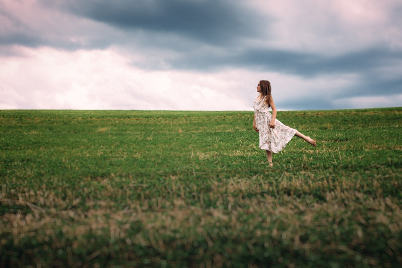 Children and Senior Photography, young girl dancing in grass field