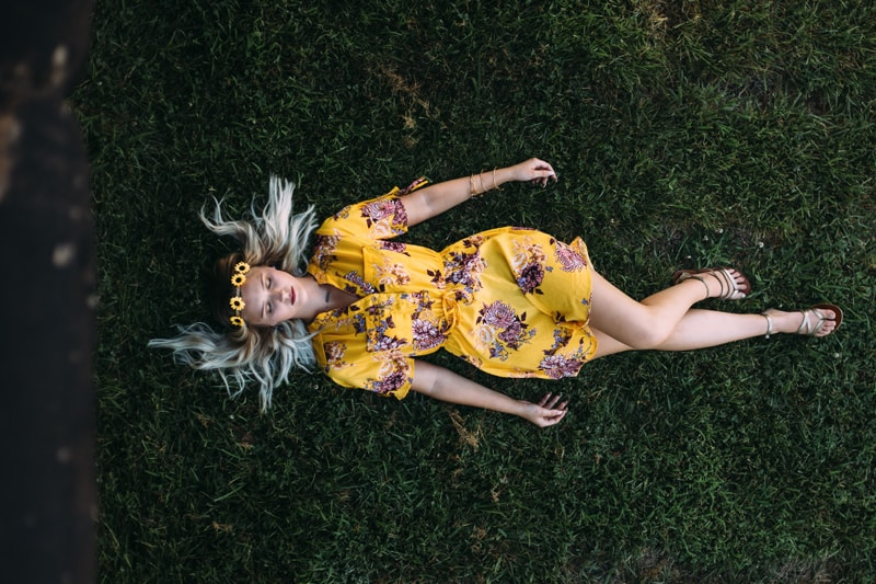 Senior Photography, young woman laying in the grass