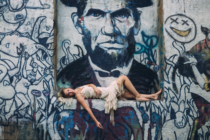 Children and Senior Photography, senior girl laying in front of mural street art