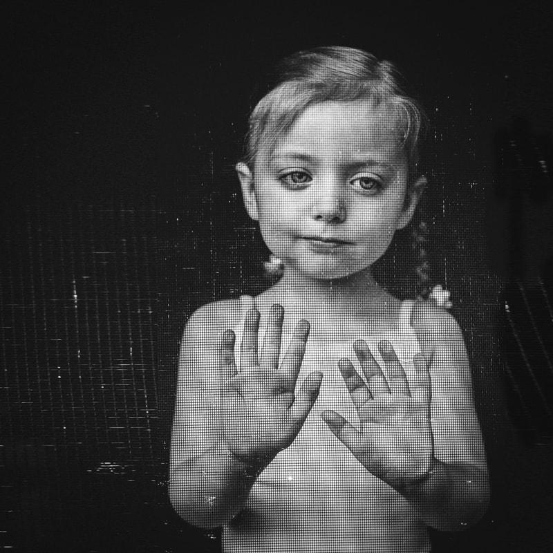 Children and Senior Photography, little girl standing behind a screen door