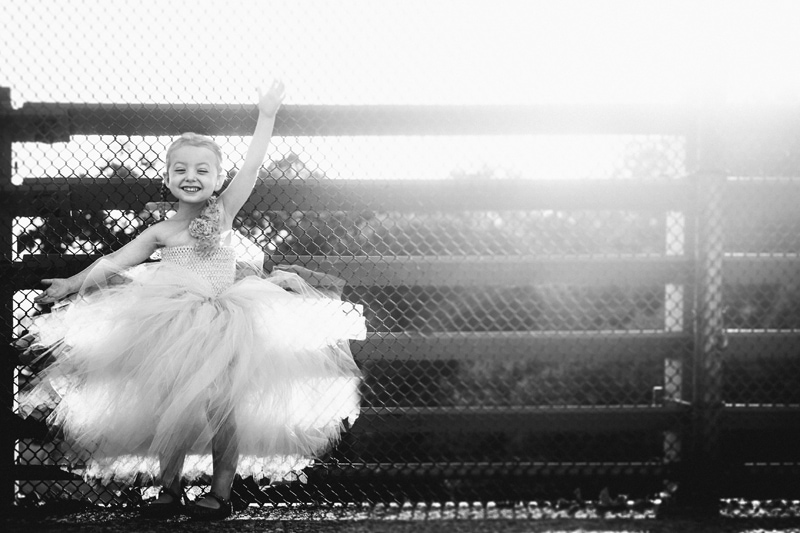 Children and Senior Photography, little girl in dress holding onto fence
