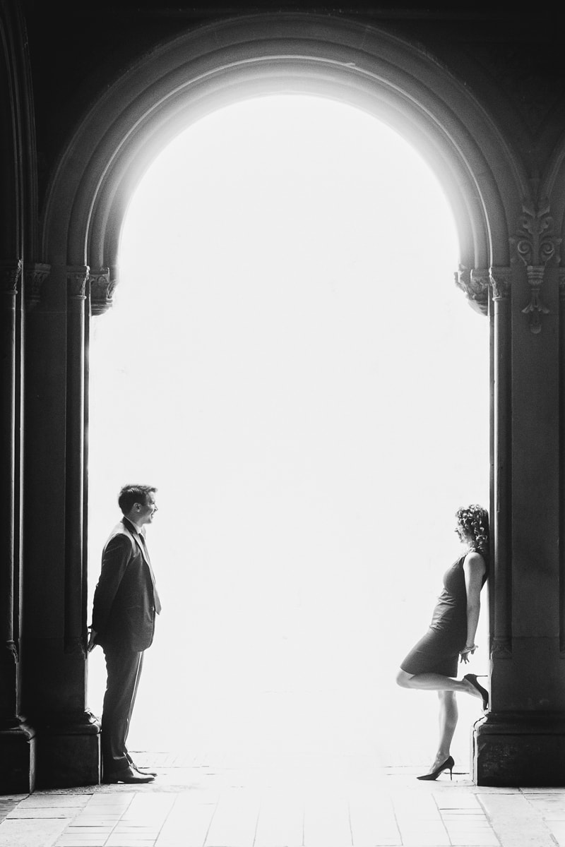 Couples Photography, black and white of couple looking at each other across a walkway
