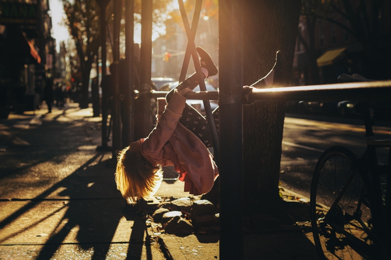 Children and Senior Photography, little girl hanging upside down from a bar