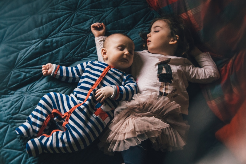 Children and Senior Photography, little sleeping siblings in same bed